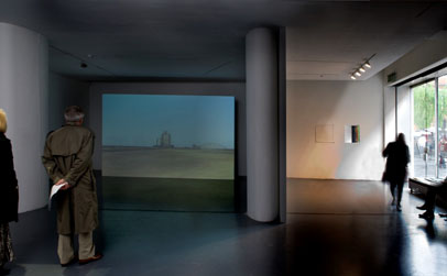 Left: John Gerrard, Dust Storm (Manter, Kansas) 2007, Realtime 3D projection (exhibition proof), 439cm x 274cm