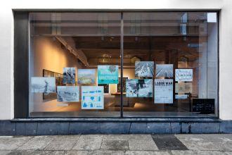 Agiation Co op gallery window news